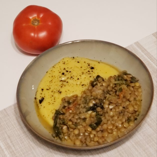 a photo of creamy lentils with spinach and cheesy polenta
